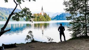 Fisherman fishing on lake Bled