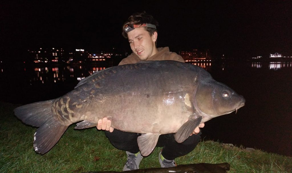 Man caught a big crap on evening fishing trip on Bled